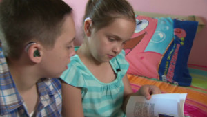 8-year-old writes hearing loss book