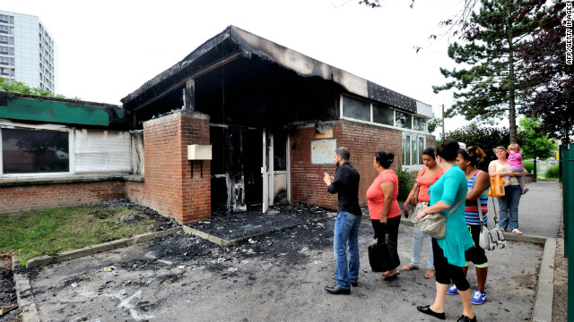 People look at a damaged primary school in Amiens, northern France. 