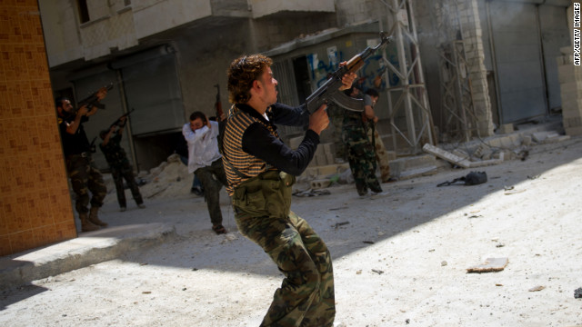 Syrian rebels fire toward a sniper in Aleppo on Monday, August 13, as fighting continues against Syrian government forces.