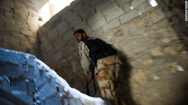 A Syrian rebel climbs a staircase in Aleppo's Salaheddin district as the opposition battles the regime.