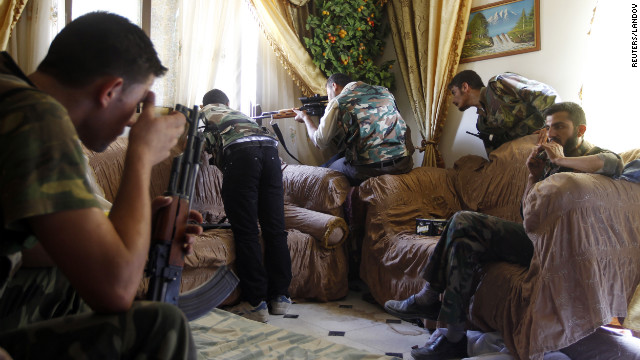 A Free Syrian Army fighter fires his rifle in Aleppo on Tuesday.
