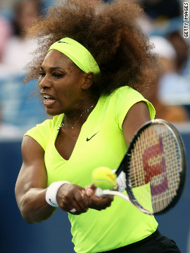 "But despite using what she called ""an '80s scrunchie,"" Williams' hair soon fought its way free in the windy conditions."