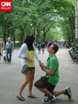 "On a day trip to New York in 2010, Christen Mishura and now-husband Corey Mishura, took a stroll in Central Park. As they prepared to have a stranger take a snapshot, Corey got down on a knee with a ring box in hand. ""Public proposals definitely add an element of fun to the pressing question at hand,"" she said. <a href='http://ireport.cnn.com/docs/DOC-826860' target='_blank'>See more about the proposal on Christen Mishura's iReport</a>."