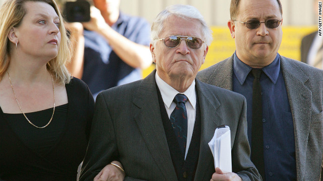 Alleged WWII war criminal Charles Zentai (C) leaves an extradition proceeding on July 19, 2005.