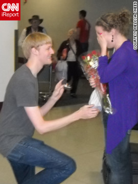 Melissa Sneed arrived at the Charlotte airport thinking her partner, Chris, was in New York. To her surprise, Chris was waiting at baggage claim, surrounded by family. &quot;We have been dating long distance for much of our relationship, so being proposed to in the airport, meant a lot to both of us.&quot; &lt;a href='http://ireport.cnn.com/docs/DOC-827003' target='_blank'&gt;Check out the video of Chris' proposal on Melissa Sneed's iReport&lt;/a&gt;.