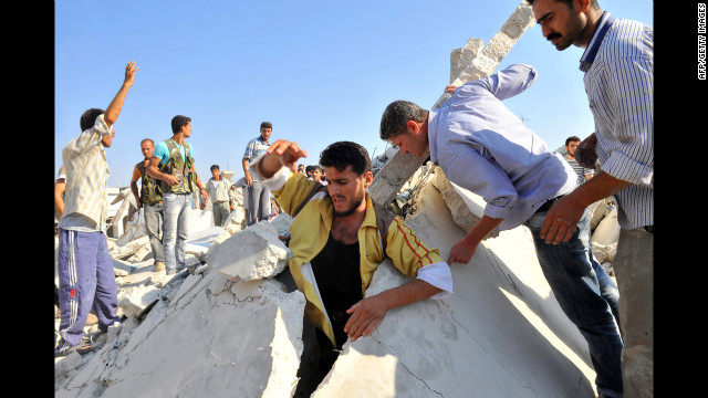 Syrians search for people trapped under the rubble after the airstrike Wednesday in Azaz, near Aleppo. 