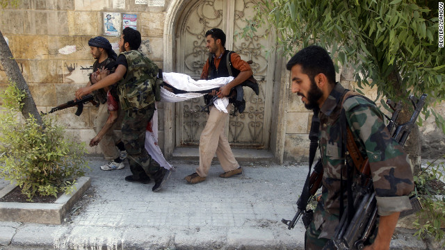 Free Syrian Army fighters carry the body of a fellow fighter during clashes Thursday in Aleppo. Government forces are pounding Syria's largest city in a siege that's become the focal point of the civil war.