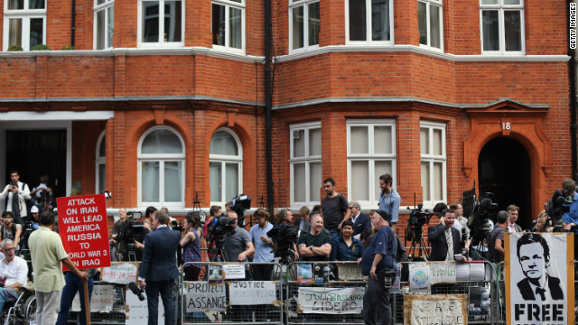 Media gather outside the Ecuadorian Embassy in London after Thursday's announcement. Meanwhile, Britain vowed to extradite the WikiLeaks founder to Sweden to face questioning on sex crime charges.