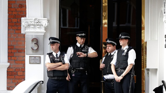 Police stand guard outside the entrance. The British government insists the UK still has a legal obligation to extradite Assange to Sweden.