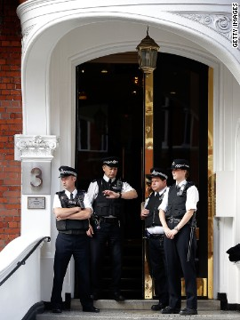 Police stand guard outside the entra<br /> 1000<br /> nce. The British Government insists the UK still has a legal obligation to extradite Assange to Sweden.