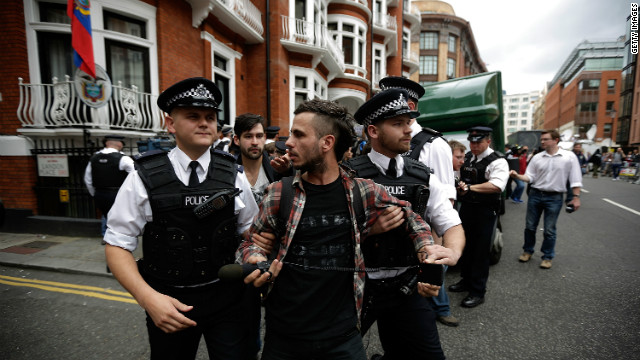 Assange supporters scuffled with police, with every moment captured by the dozens of cameramen gathered outside. 