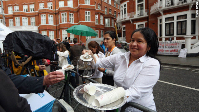 Embassy staff serve coffee to the media waiting outside the building for a glimpse of Assange.