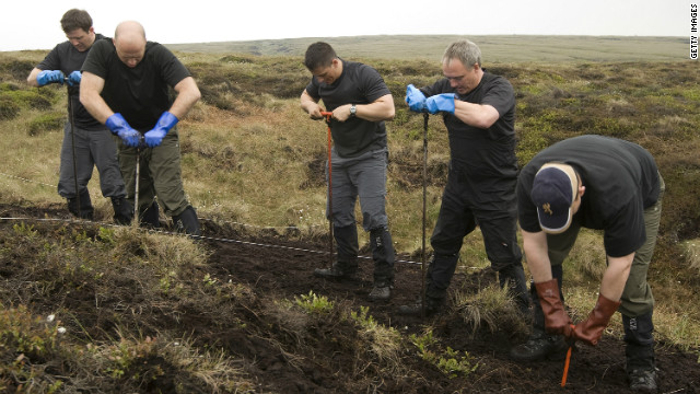 A police search team looks for the body of 12-year-old murder victim Keith Bennett in 2003 as part of a new attempt to find his remains.