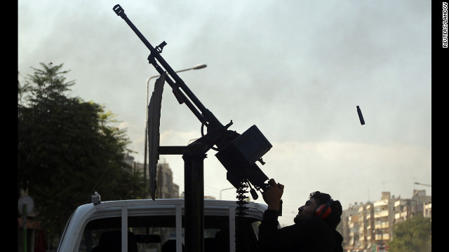 A Free Syrian Army fighter fires an anti-aircraft gun at a Syrian air force helicopter in Aleppo on Thursday, August 16. The northern city of Aleppo has been the center of some of the worst fighting in the 18-month-old conflict.