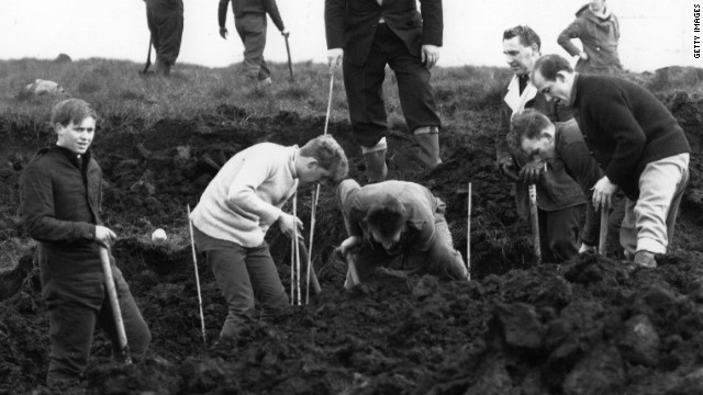 Policemen digging at the scene where the body of the fourth victim Lesley Ann Downey was found in 1965. In 1987 Brady and Hindley admitted to the killing of two other children, 16-year-old Pauline Reade and Keith Bennett.
