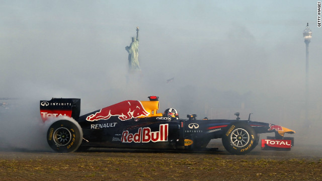 Coulthard burns rubber, while the Statue of Liberty can be seen poking through the thick cloud of smoke.