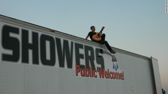 Evan Jensen, 18, rests atop his shower truck, which he helped build along with his family after noticing there was no place to get a decent shower in the oil boomtown of Williston, North Dakota.