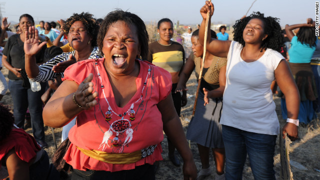 Protesters gather in Marikana, South Africa, on Friday, August 17, at the scene where 34 people died a day earlier after police opened fire on striking mineworkers. Police say they fired at the striking workers in self-defense. Marikana was one of the bloodiest incidents since the end of apartheid in 1994. 