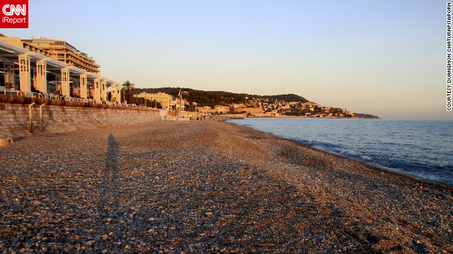 Duangmon Chaturapitaporn <a href='http://ireport.cnn.com/docs/DOC-829157'>captured this image</a> at sunset on the beach along Nice's Promenade des Anglais.