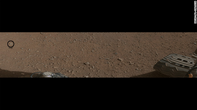 This image shows what will be the rover's first target with it's chemistry and camera (ChemCam) instrument. The ChemCam will fire a laser at the rock, indicated by the black circle. The laser will cause the rock to emit plasma, a glowing, ionized gas. The rover will then analyze the plasma to determine the chemical composition of the rock.