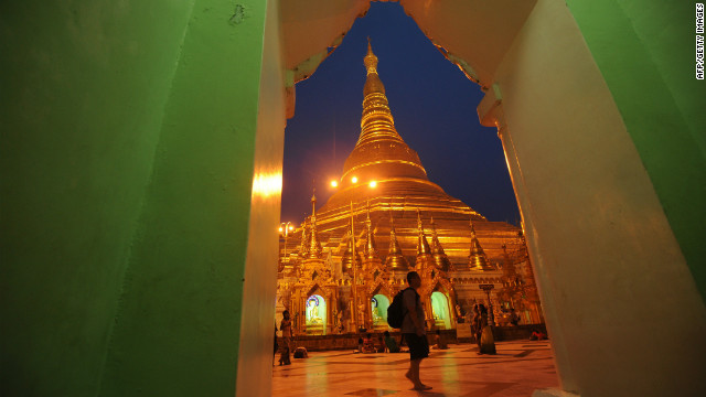 This pcture taken on June 1, 2012 shows a tourist visiting the Shwedagon Pagoda in Yangon.