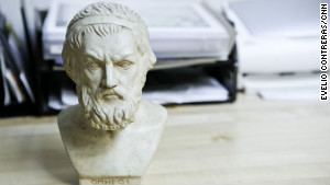 Among the items decorating Katz\'s office is a bust of Homer found at a garage sale.