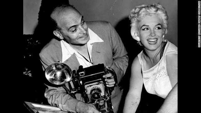 Mike Rotunno was a newspaper photographer who started a business at Midway Airport in 1930s Chicago shooting pictures for travelers who wanted a memento as they passed through. Many celebrities were among them. Here, Rotunno poses with Marilyn Monroe in 1955.