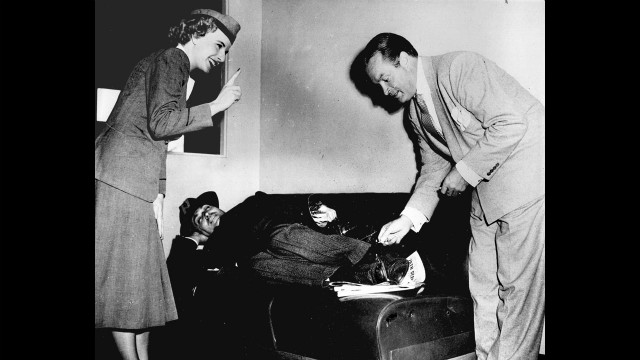 "Bob Hope pretends to give Rotunno a ""hotfoot"" as a stewardess admonishes him in the 1940s."