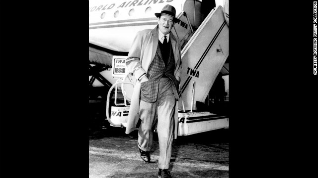 A well-turned out John Wayne ambles away from a TWA flight at Midway in the '50s.