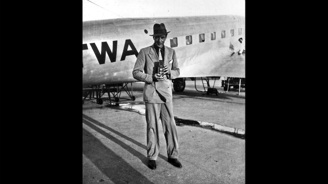 Gary Cooper turns his camera on Rotunno, also taking a picture, late 1930s.