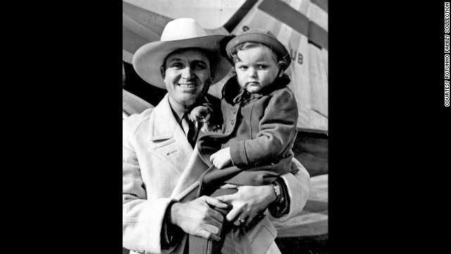 Gene Autry holds Rotunno's daughter Judy, 1930s.