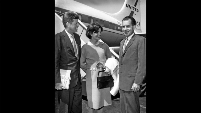 Sen. John F. Kennedy, Jaqueline Kennedy and Richard Nixon on the tarmac in 1959.