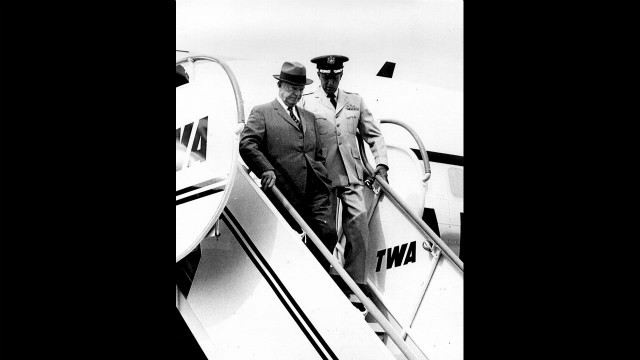 President Dwight D. Eisenhower steps from a TWA flight in the 1950s.