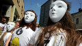 Demonstrators wear Pussy Riot-style masks outside a Moscow court in July. Singer Madonna also donned one of the masks during a recent gig in the city, telling the audience: