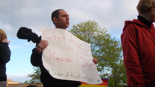 Andrew Shirvell, in an undated photo, holds a poster denouncing UM's then-student body president, Chris Armstrong.