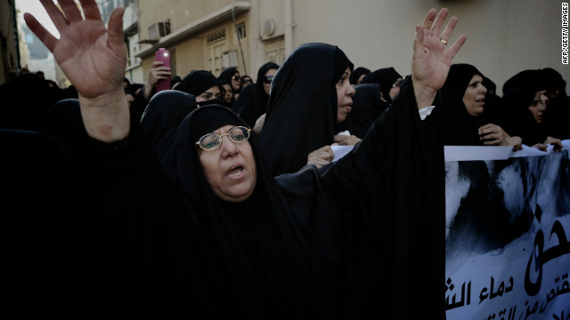Bahraini Shiite Muslim women attend the funeral of 16-year-old Hussam al-Haddad in Muharreq on August 18, 2012.