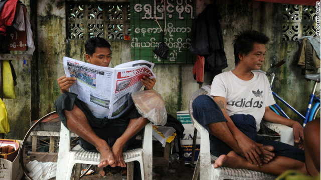 A man reads a local journal in Yangon on Monday.