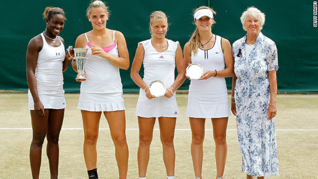 Her junior career included three consecutive doubles titles at the French Open, Wimbledon (pictured) and the U.S. Open with Timea Babos from Hungary (second left) in 2010.