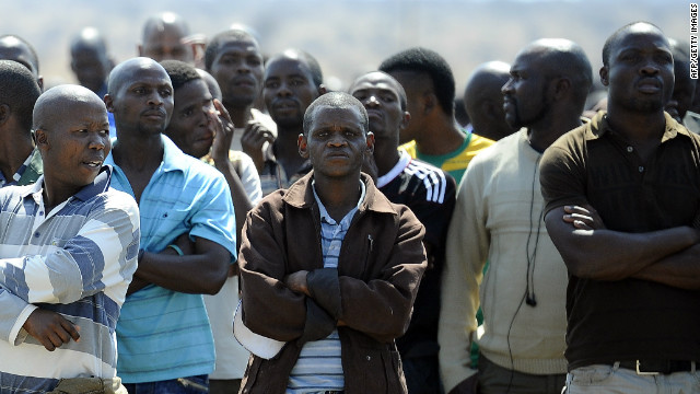 Striking workers gather on August 20 at the Lonmin-owned platinum mine in Marikana, 10 days after 3,000 miners began an illegal strike over pay.