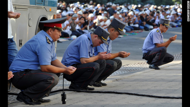 Policemen pray on the first day of Eid al-Fitr at a square in central Bishkek, Kyrgyzstan, on Sunday.