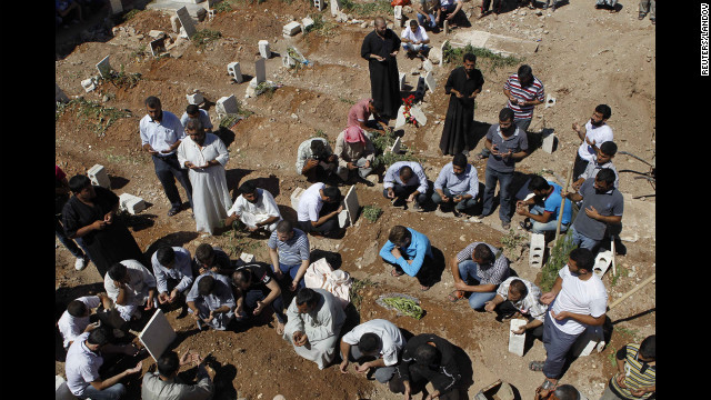 People pray during the funeral of a Free Syrian Army fighter, Amar Ali Amero, on August 21.