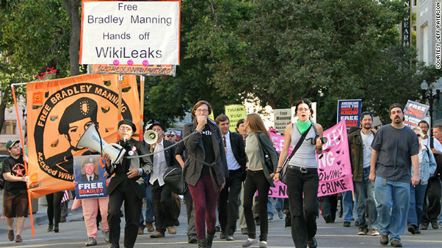 Protesters march toward the Obama campaign headquarters Thursday to demand Bradley Manning's release.