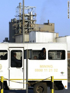 Miners arrive at the Marikana mine on August 21 after owners Lonmin gave striking workers until 0500 GMT to return to their jobs or face dismissal. 