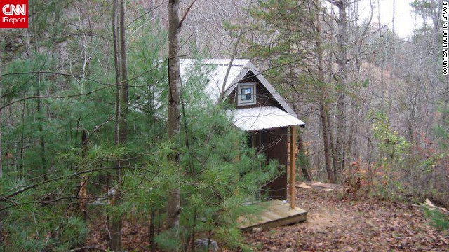 "Realizing that their 2,700-square-foot home was becoming too much of a maintenance burden, Laura M. LaVoie and her partner decided to dramatically downsize to a 120-square-foot home in a remote area of North Carolina. ""Tiny house living isn't for everyone,"" she said. "" But living differently will profoundly change you no matter how you do it."" <br/><br/><br/><br/><a href='http://ireport.cnn.com/docs/DOC-814844' target='_blank'>Find out more about their off-the-grid house on Laura M. LaVoie's iReport</a>."