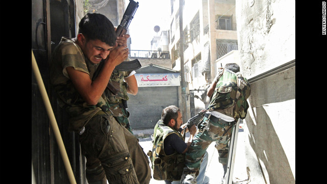 Members of the Free Syrian Army clash with Syrian army soliders in Aleppo's Saif al-Dawla district on August 22.