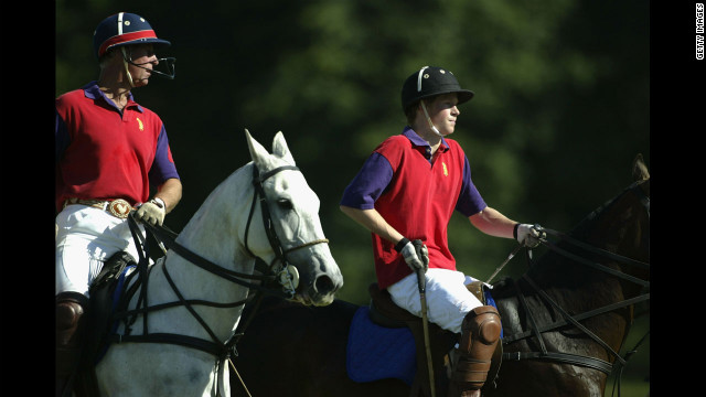 Britain's Prince Harry, right, and his father The Prince Of Wales play polo for The BFF/Highgrove Team in a match for The Indian Cavalry Polo Trophy in Tidworth, England, on July 12, 2003.