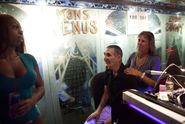 Club owner Joe Redner gets a back massage from Lorry Kasner at Mons Venus.