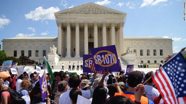 Protesters shout slogans during a protest against Arizona's immigration law outside of the U.S. Supreme Court in April.