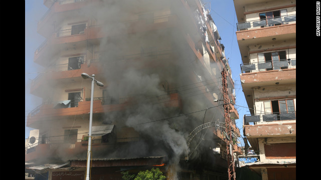 Smoke billows from a building in Tripoli's Bab al Tabaneh area Tuesday following fighting between the two groups. Resentment from the nearly 30-year Syrian occupation still lingers in Lebanon, which struggles to maintain a balance among its religious and ethnic sects. 