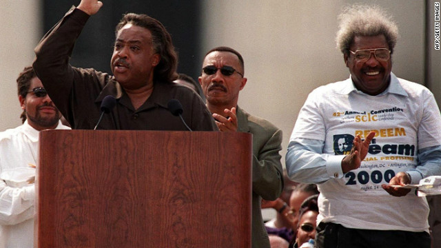 King applauds during a speech in August 2000 by the Rev. Al Sharpton during a celebration honoring the 37th anniversary of Martin Luther King, Jr.'s &quot;I Have a Dream&quot; speech in Washington, D.C.